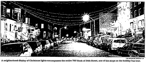 Black and white image from the Baltimore Sun of 34th Street in Hampden, with lights strung across the street.